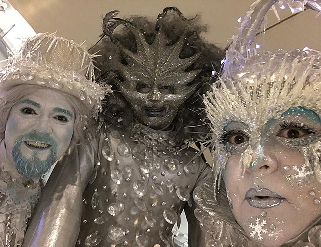 Frost Themed Stilt Walkers wearing white, blue and silver costumes with frost and icy accents.