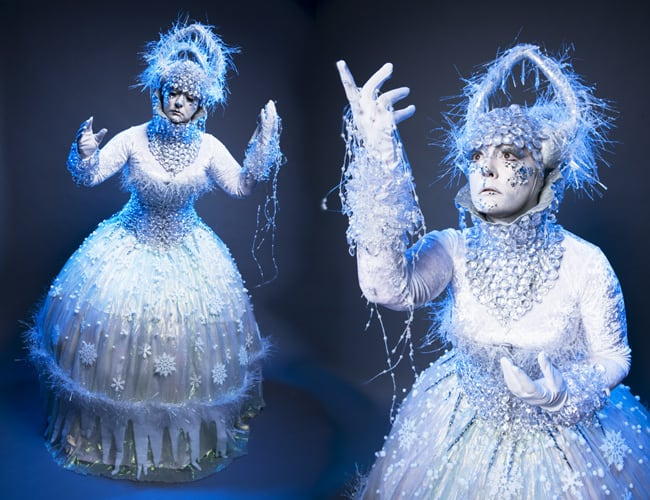 Ice Themed Stilt Walker Performers wearing white and blue icy costumes.