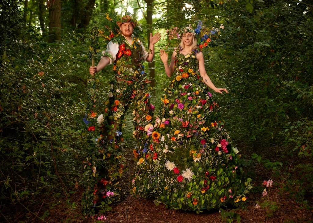 Flower stilt walkers for hire. The Blossom stilt walkers are available to book for private events in London & the UK.