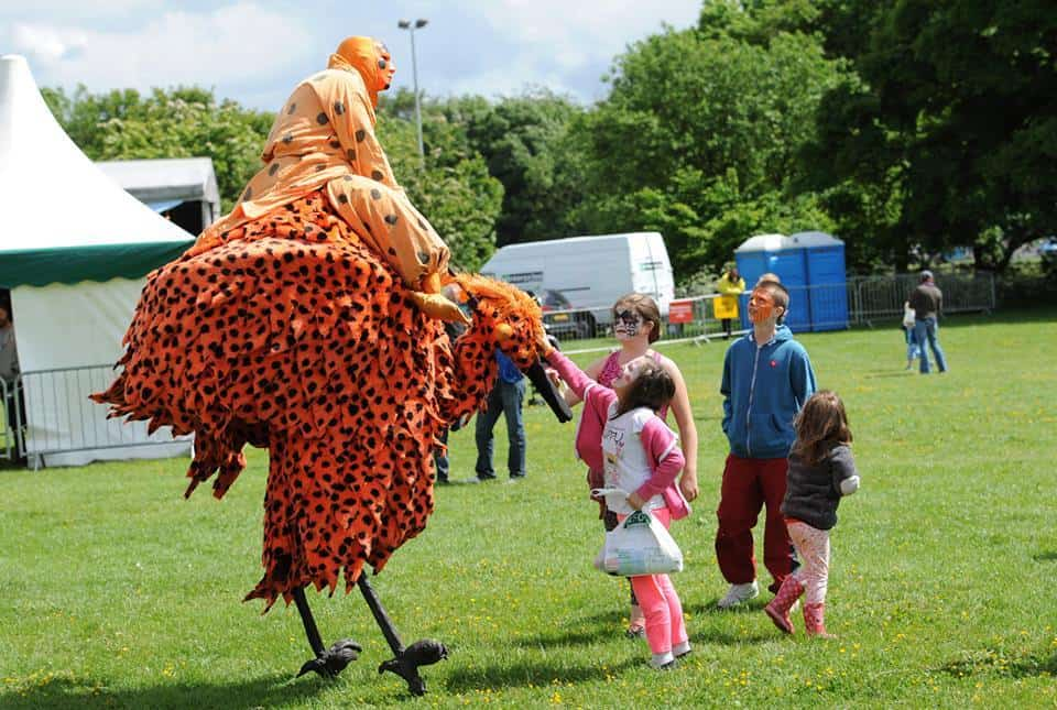 Animal-themed stilt walkers for hire. Book our Tropical Bird Stilt Walkers for family fun days in the UK & London.