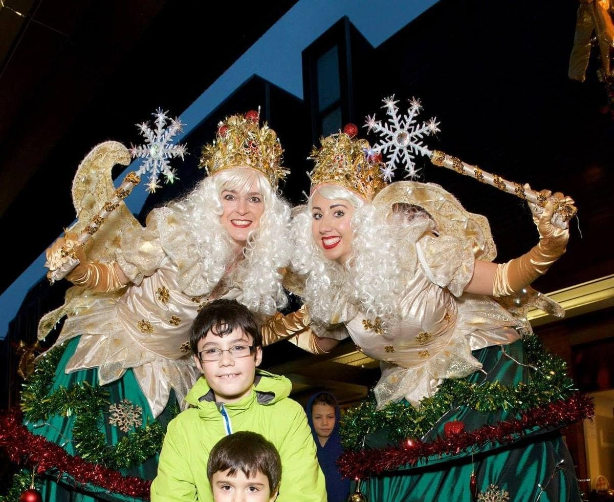 Christmas Tree Fairy Stilt Walkers for hire. Book our Christmas Tree Fairy Walkabout act for Christmas-themed events in London & the UK.