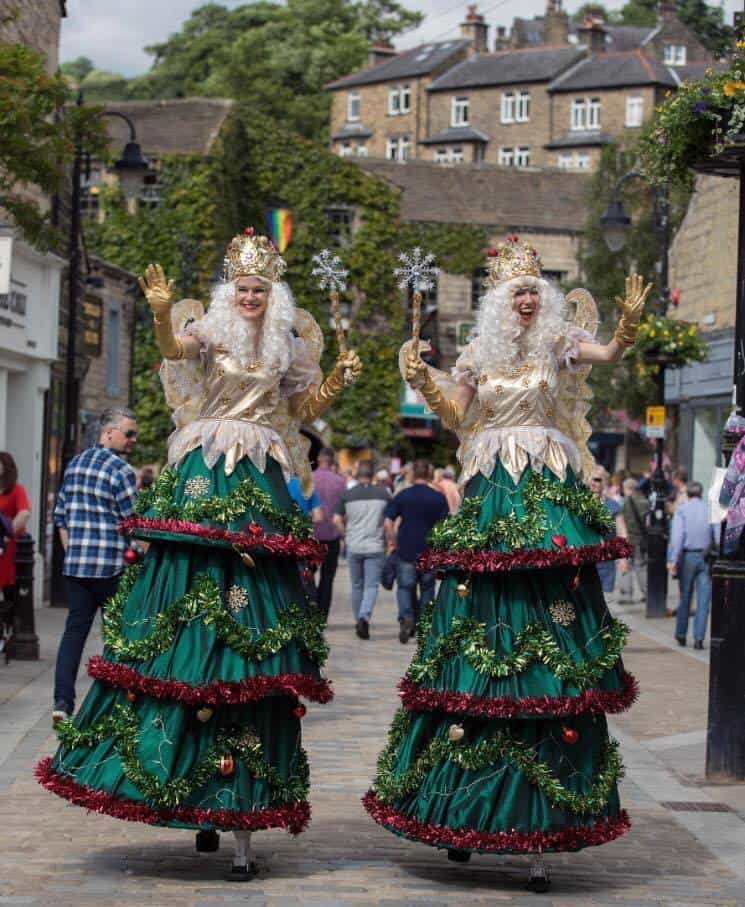 Christmas Tree Fairies for hire. Our Christmas Tree Fairy stilt walkers are available to book for corporate events, Christmas-themed events or shopping centre events in London & the UK.