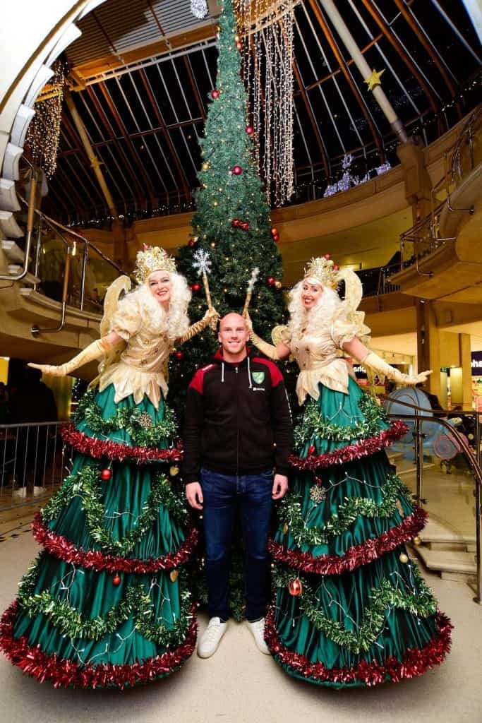 Christmas Tree Fairies for hire. Book our Christmas Tree Fairy Stilt Walkers are available to book for Christmas-themed corporate events in London & the UK.