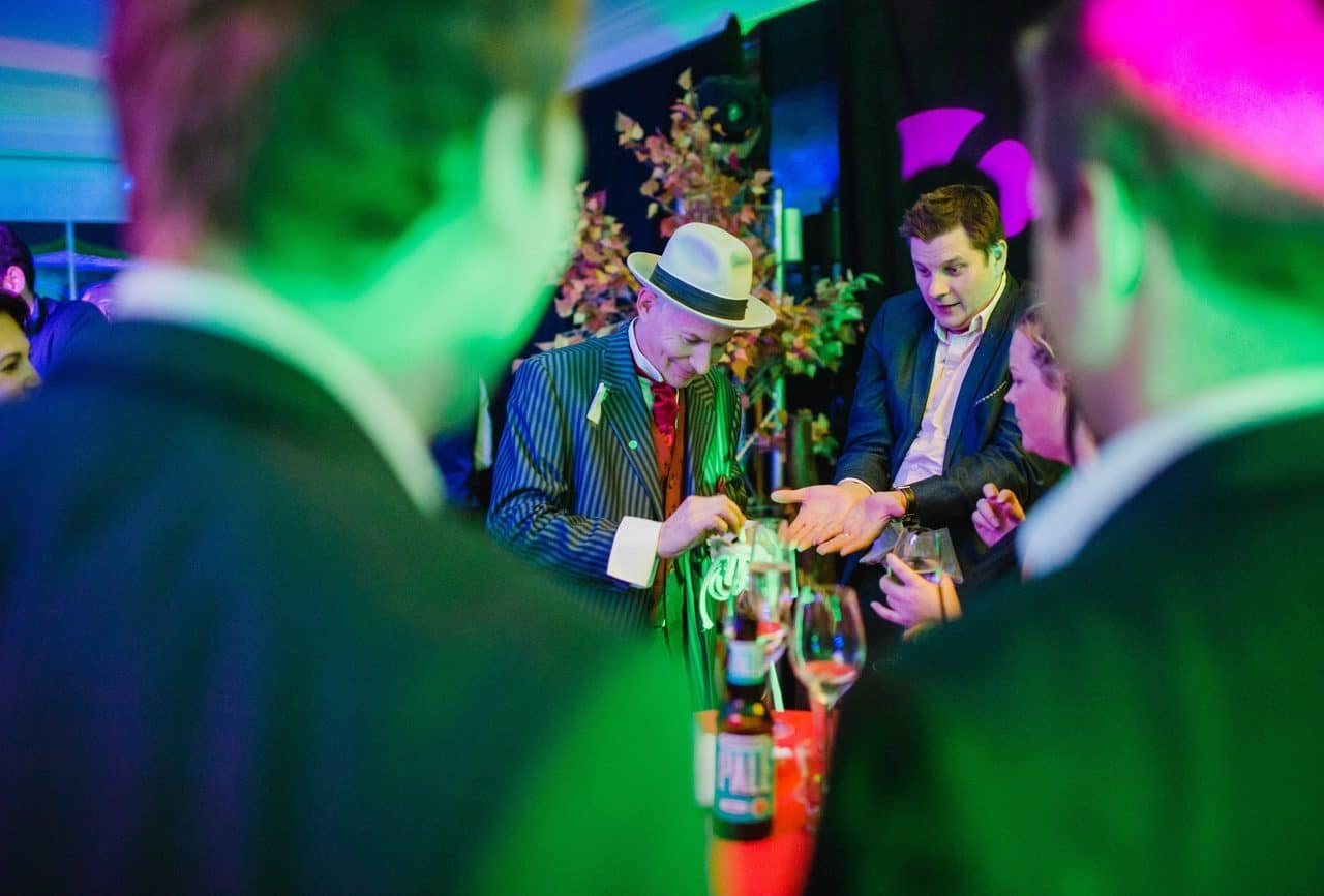 Magician entertaining guests at our Twisted Alice in Wonderland party at the Conrad Hotel.