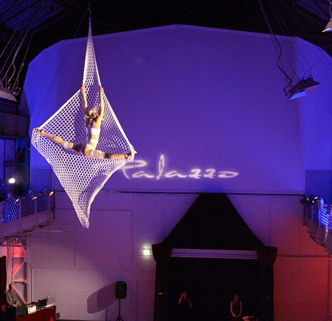 Aerial Net Performer for hire. Book our aerial acrobat for product launches, gala dinners or corporate events in London & the UK.