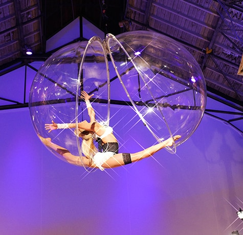 Aerial bubble Act for hire. Book our aerial acrobat for brand activations in the UK & London.