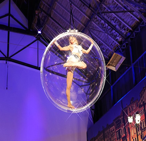 Aerial Bubble Aerial Act for hire. Book our aerial acrobatic show for corporate events in the UK & London.