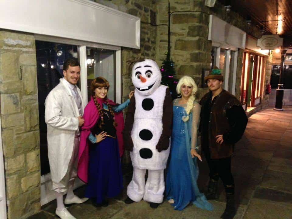 Frozen walkabout characters for hire. Our Queen Elsa & Princess Anna walkabout acts are available to book for Christmas-themed events in the UK & London.