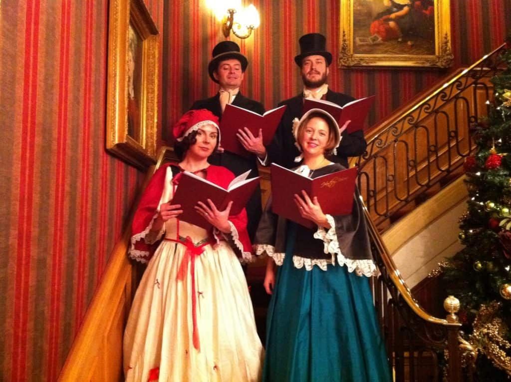 The Hart Carollers for hire. Our Christmas carol singers are available to book for Christmas-themed events, Victorian-themed events or Dickensian-themed events in London & the UK.