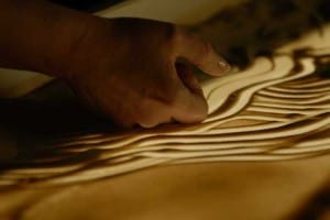 Ilana Yahav Sand Artist for hire. Our Sand Sculptor is available to book for gala dinners in London & the UK.