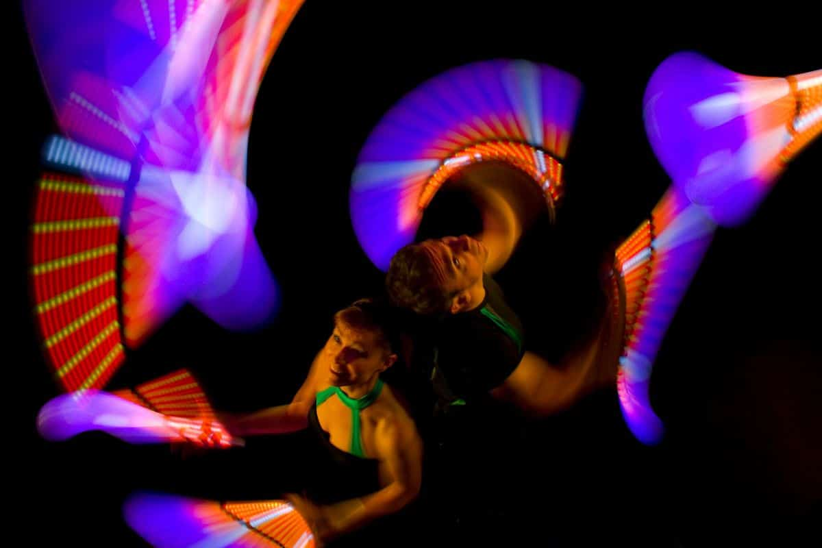 LED Poi juggling show for hire. Book our LED Poi Jugglers for conferencing events in the UK & London.