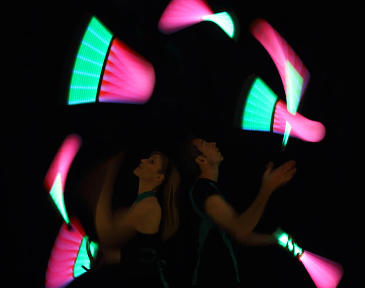 LED Poi dance show for hire. Our LED Poi Jugglers are available to book for gala dinners in London & the UK.