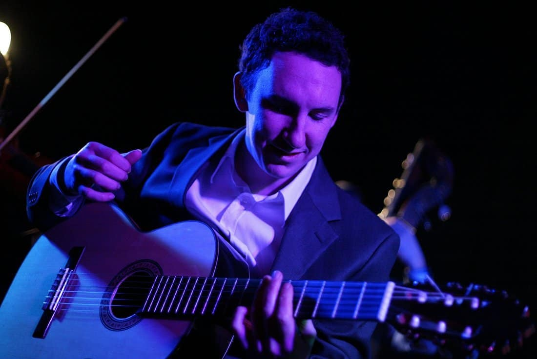 UK-based classical guitarist for hire. Book our solo Spanish guitarist for corporate events or weddings.