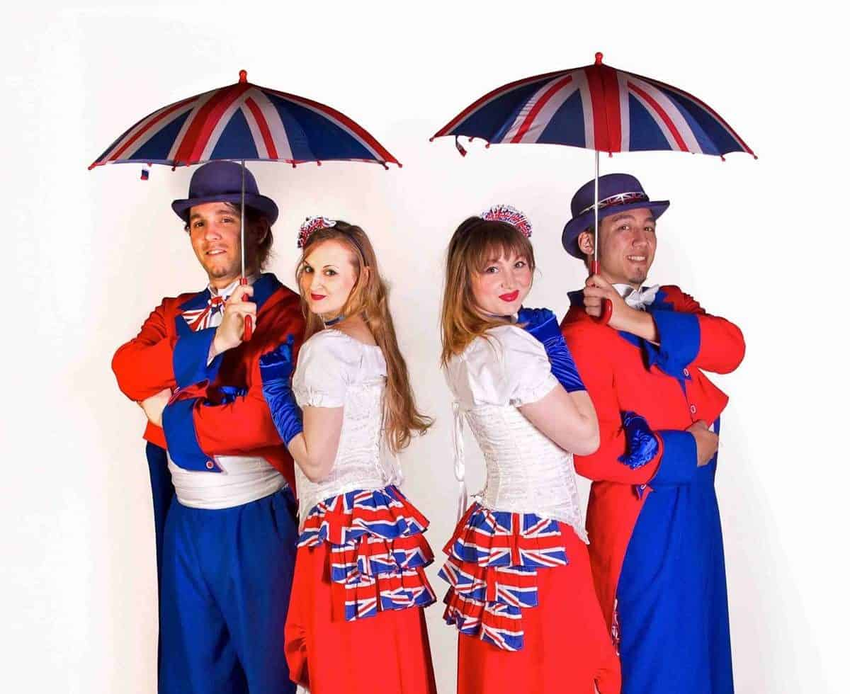 The Noble Union Jacks for hire. Our union jack stilt walkers are available to book for St. George's Day events, British-themed events or picnic events in London & the UK.