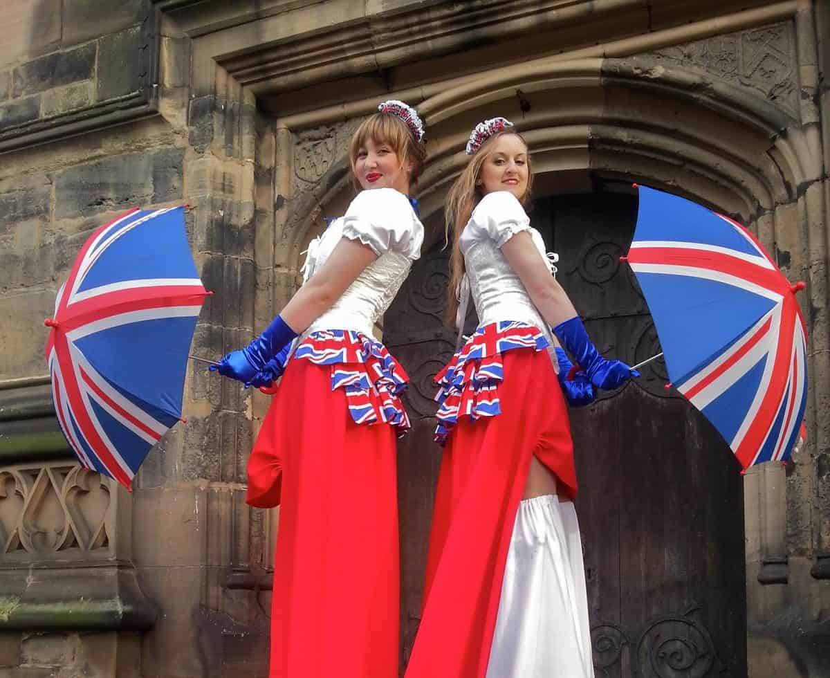The Noble Union Jack stilt walkers for hire. Book our union jack stilt walkers for public events in the UK & London.