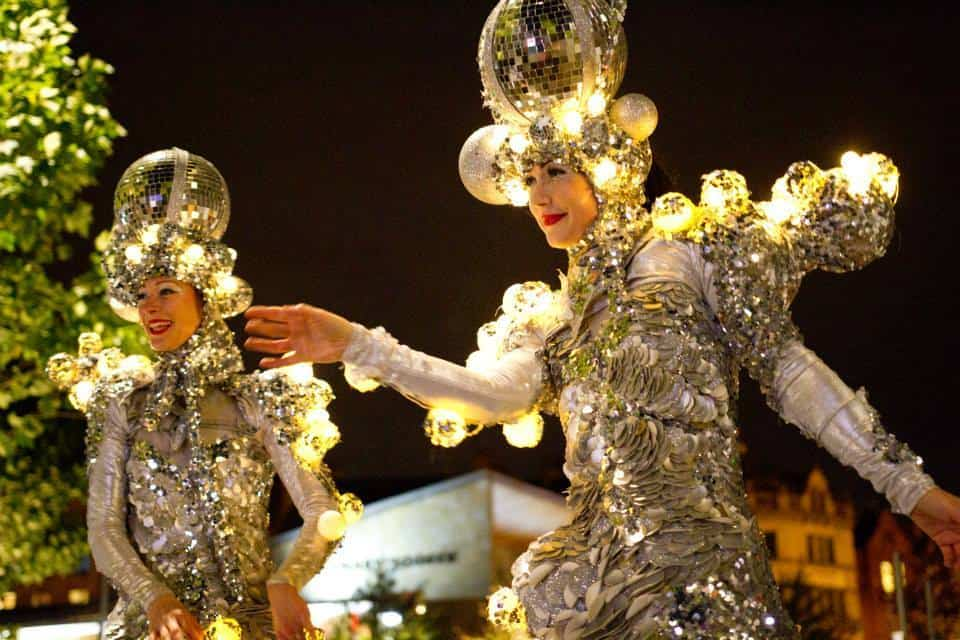 Christmas-themed stilt walkers for hire. Our Glitter Ball Stilt Walker is available to book for corporate events in the UK & London.
