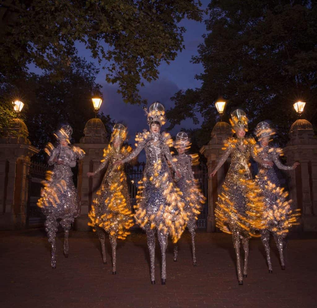 Winter Wonderland-themed stilt walkers for hire. Book our Glitter Ball Stilt Walkers for Christmas-themed events in London & the UK.