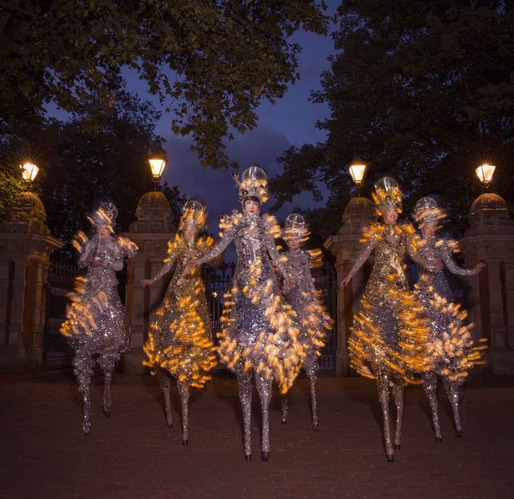 Winter Wonderland-themed stilt walkers for hire. Book our Glitter Ball Stilt Walkers for Christmas-themed events in London & the UK.