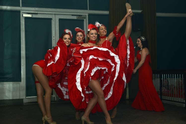 Cabaret Style Show Dancers wearing puffy red and white cabaret style clothing.