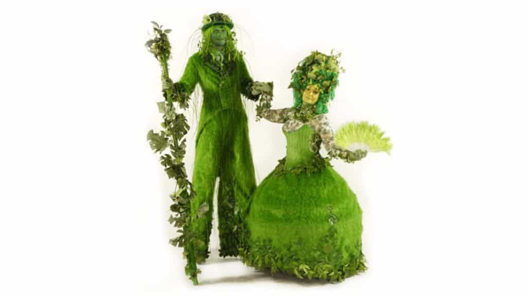 Family Tree performer duo in full green topiary costumes.