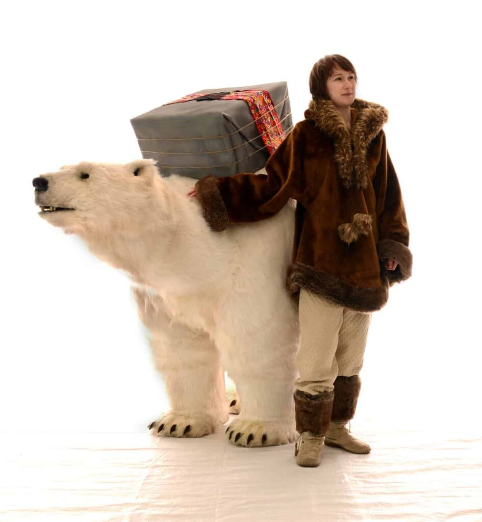 White Polar Bear and Woman in Winter Clothing characters that perform our Interactive Polar Bear Show.