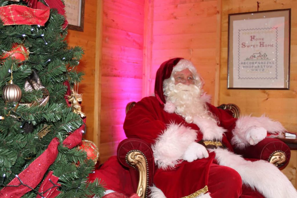Santa Claus performer inside our bespoke Christmas Grotto at the Newmarket BID public Christmas event.