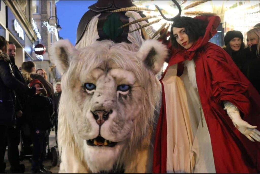 Snow Lion and Winter Queen Christmas Characters at a public event.