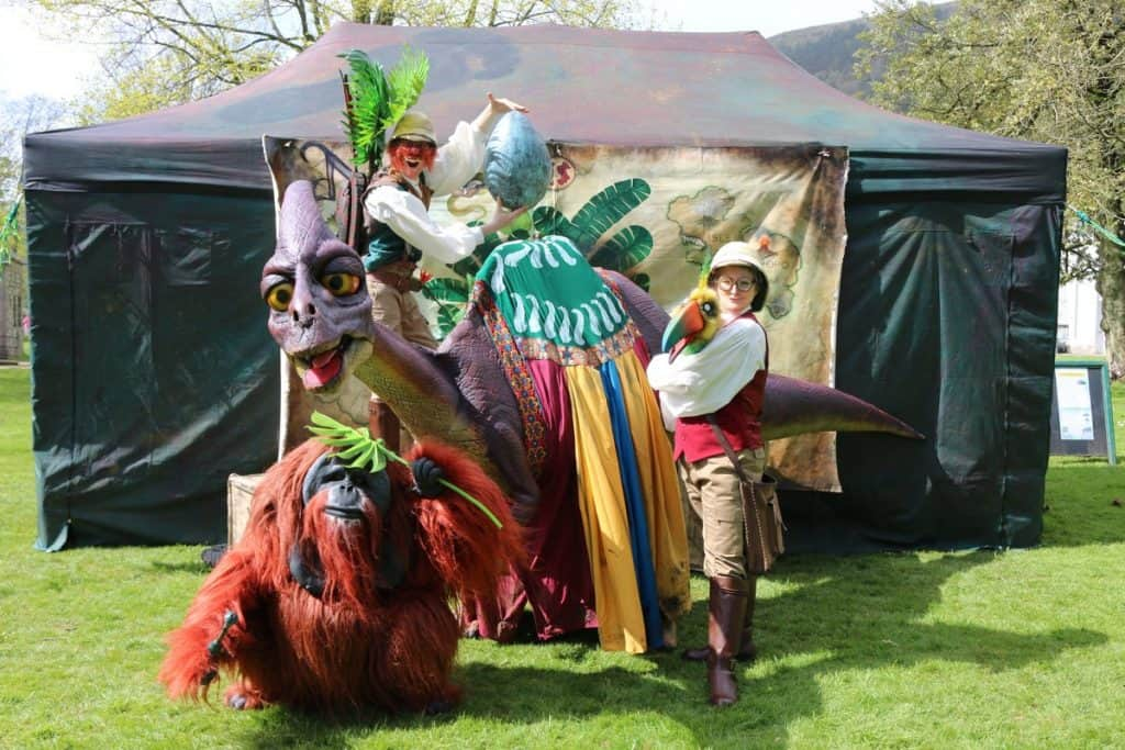Walkabout animals & explorers for hire. Book our walkabout animal puppet show for summer festivals in London & the UK.