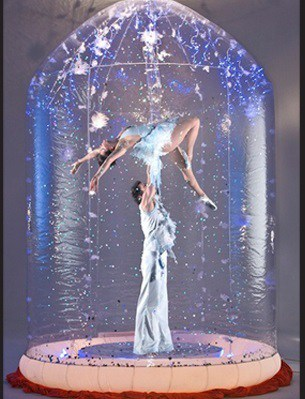 Christmas-themed performers for hire. Our Human Snow Globe is available to book for corporate events in London & the UK.