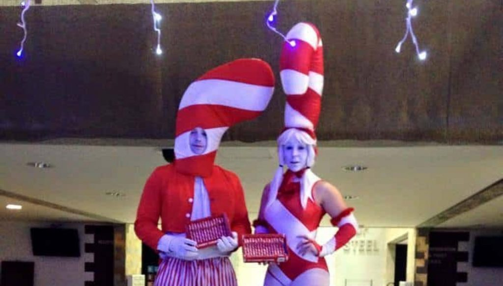 Candy Cane Stilt Walkers available to book for Christmas Events in the UK as entertaining Christmas Stilt Walkers.