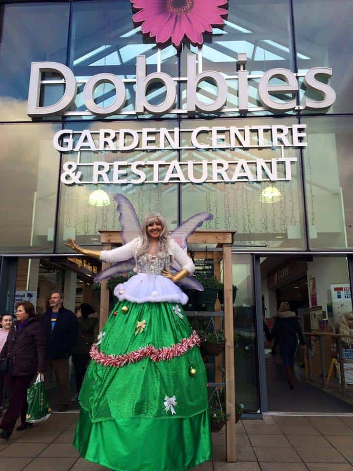 Christmas stilt walker for hire. Our Christmas Tree Fairy is available to book for Christmas parades in London.