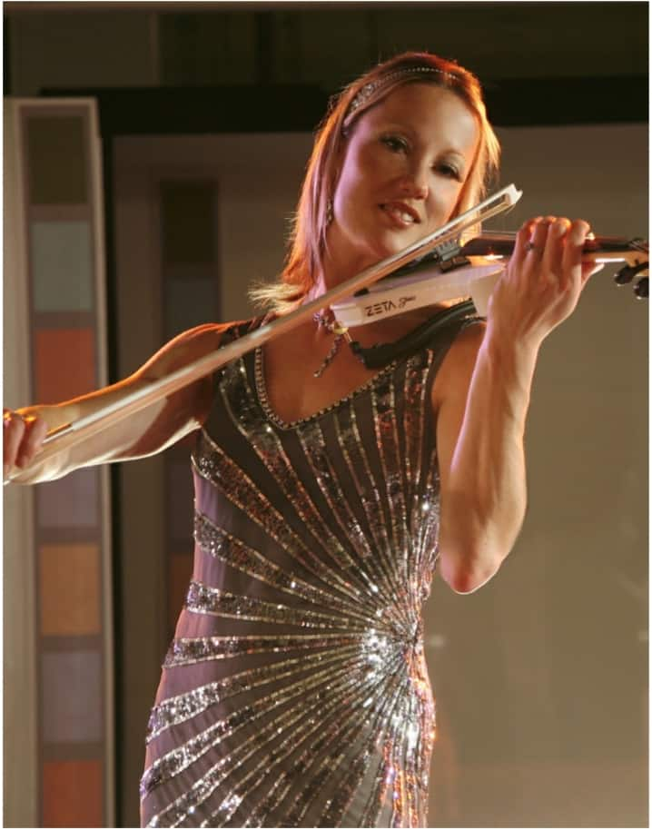 The Electrifying Sarah for hire. Book our contemporary electric violinist for product launches in London & the UK.