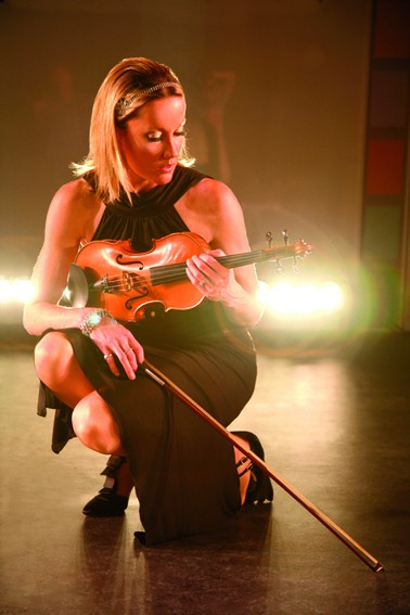 International violinist for hire. Book our electric violinist for award ceremonies in the UK & Europe.