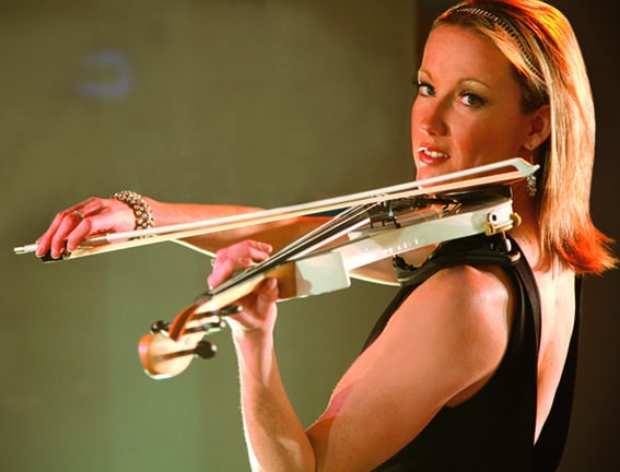 The Electrifying Sarah for hire. Our electric violinist is available to book for corporate events, gala dinners or award ceremonies in London & the UK.