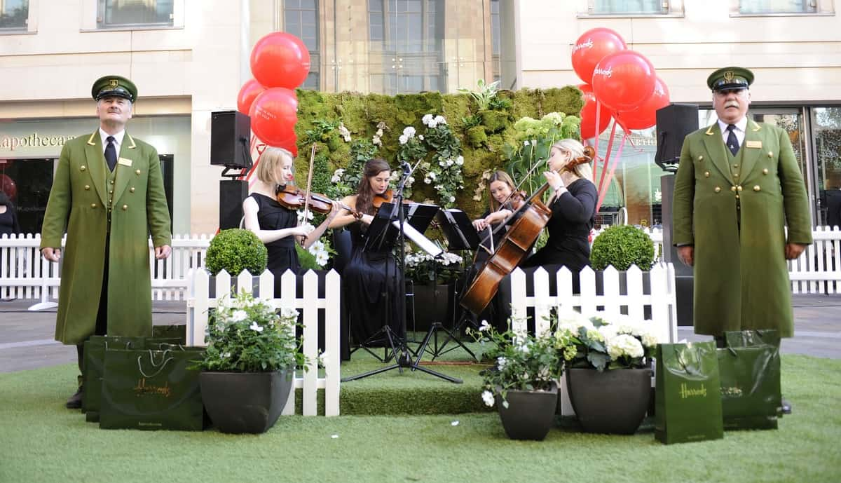 Classical string ensemble for hire performing outside Harrods.