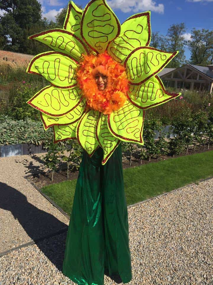 Floret the Sunflower for hire. Our sunflower stilt walker is available to book for eco-themed events, Easter events or family fun days in London & the UK.