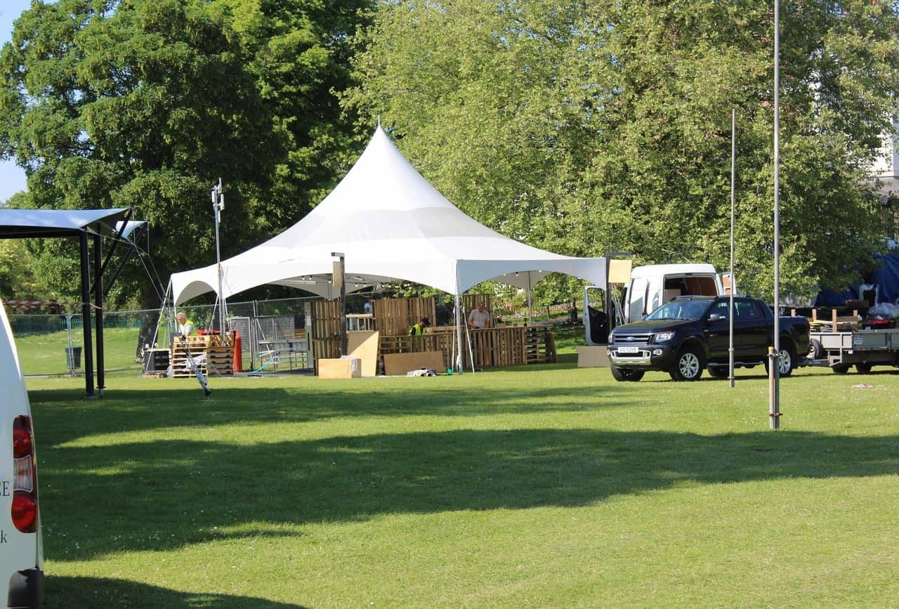 Tent set-up for the pallet bar at Pub In The Park, Bath.