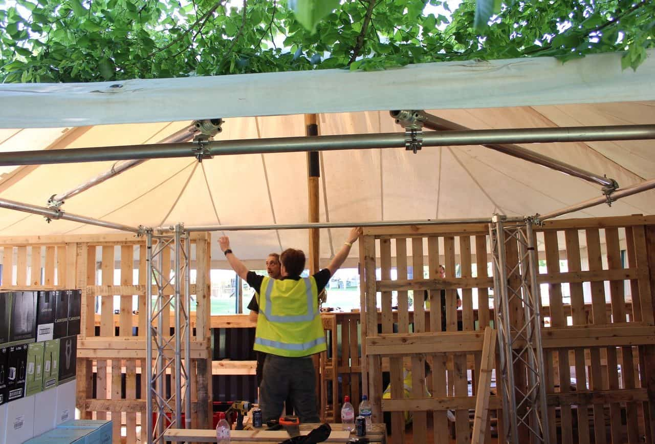 Some of the team members setting up the bespoke outdoor bar.