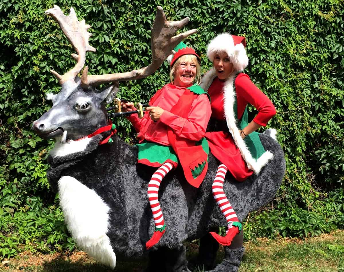 Reindeer & Christmas Elves Walkabout act for hire. Our meet and greet act is available to book for Christmas-themed events in London & the UK.