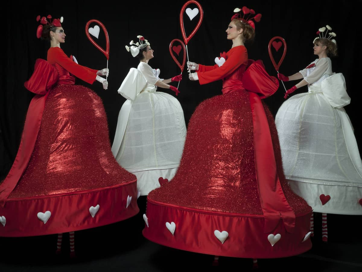 Sparkling red stilt walkers for hire. Our Love Heart Belles are available to book for Valentine's Day events in the UK & London.
