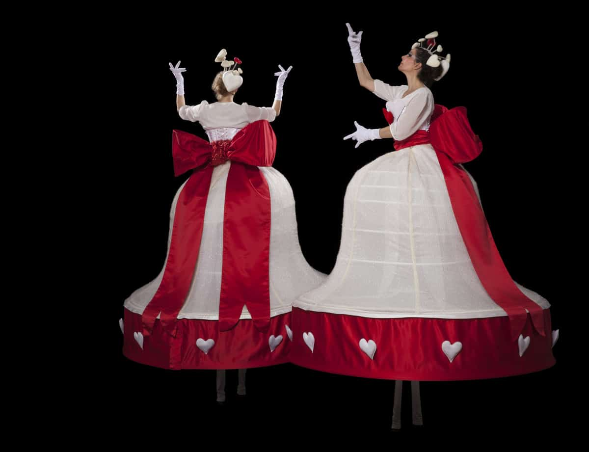 Red & white stilt walkers for hire. Book our Love Heart Stilt Walkers for corporate events in London & the UK.