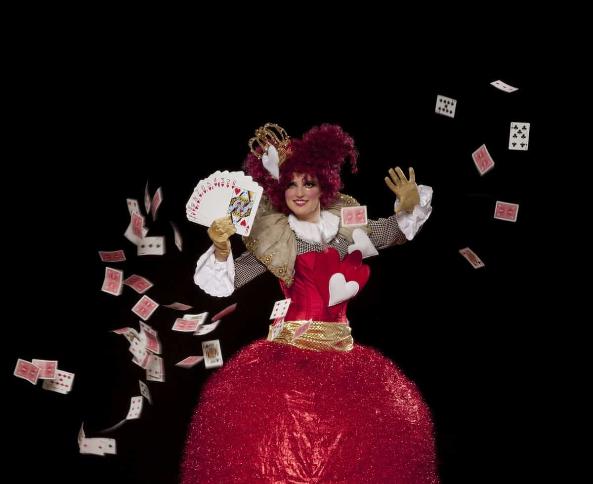 Love Heart Belle stilt walkers for hire. Our Queen of Hearts stilt walker is available to book for Alice in Wonderland-themed events in the UK & London.
