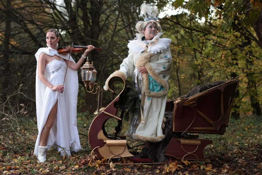 Musical Snow Queen Chariot for hire. Our Snow Queen Chariot & violinist is a unique Christmas musical entertainer available to book for Winter Wonderland events, Christmas-themed events or corporate events in London & the UK.