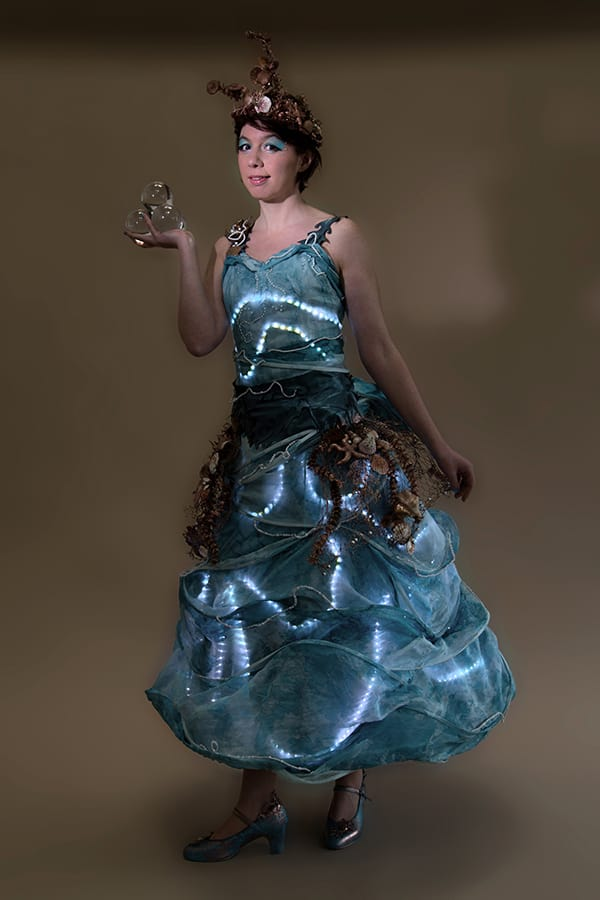 LED ocean-themed performer for hire. Book our Ocean Goddess walkabout performer for children's events in the UK & London.