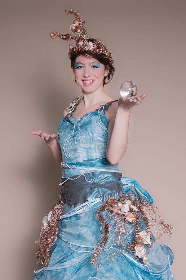 Ocean Goddess walkabout performer for hire. Our aquatic-themed contact juggler is available to book for ocean-themed events in London & the UK.