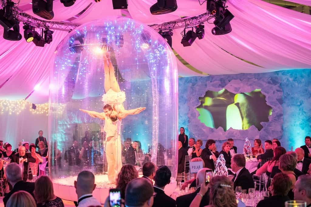 Human Snow Globe for hire. Our Christmas meet & greet act is available to hire for Winter Wonderland-themed events, corporate functions or gala dinners in London & the UK.