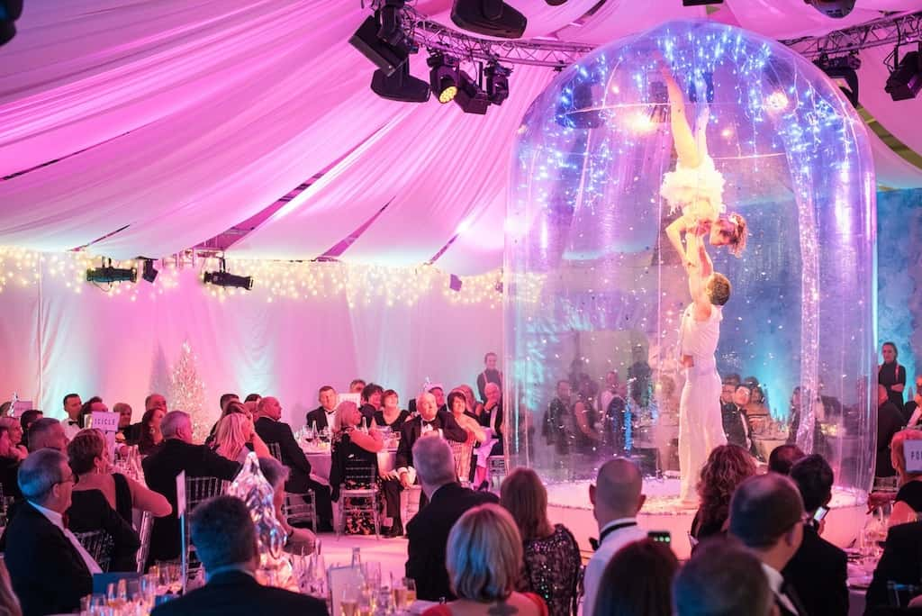 Christmas-themed meet & greet act for hire. Our Human Snow Globe is available to hire for Winter Wonderland-themed events in the UK & London.