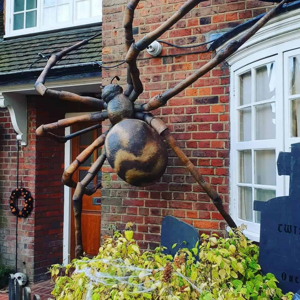 Large Spider Prop hanging on the front of the house for the annual Hampstead Way, London Halloween Street Party.