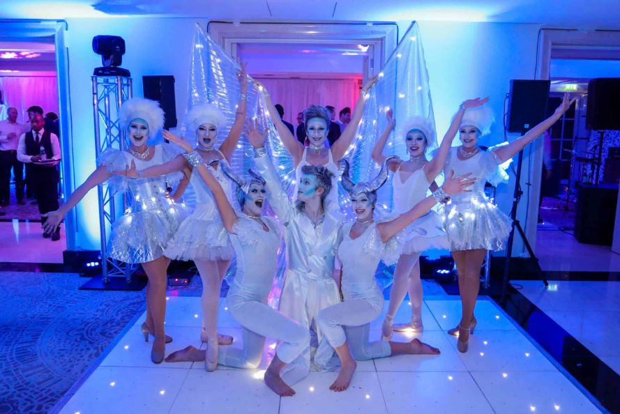 Winter Wonderland Performer group on the Dance Floor we created inside the Conrad Hotel, London, for our client's Winter Wonderland Christmas Party.
