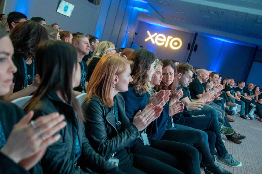 Xero staff applauding Xero CEO Steve Vamos who spoke on stage at the 2019 Xero Conference we organised in Milton Keynes.